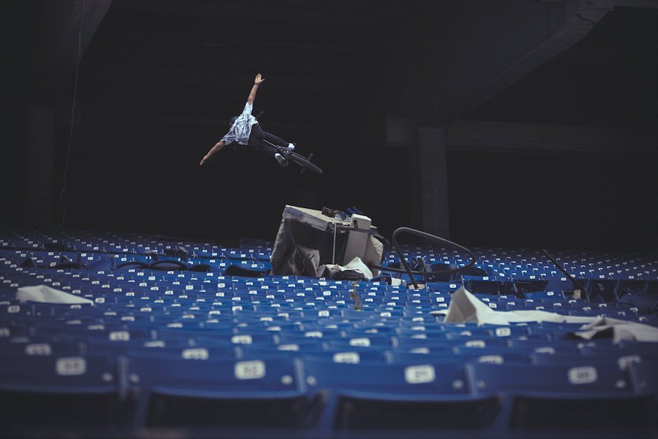 Tyler Fernengel performs a no-hander inside the abandoned Silverdome Stadium during Red Bull Revival in Pontiac, MI, USA, on 12 May, 2015. // Ryan Fudger / Red Bull Content Pool // P-20150606-00040 // Usage for editorial use only // Please go to www.redbullcontentpool.com for further information. //
