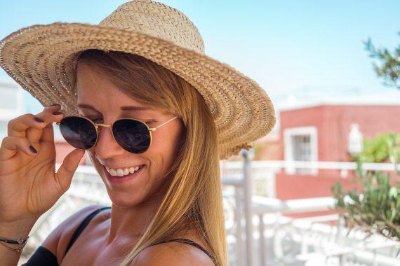 woman smile straw hat sun sunglasses