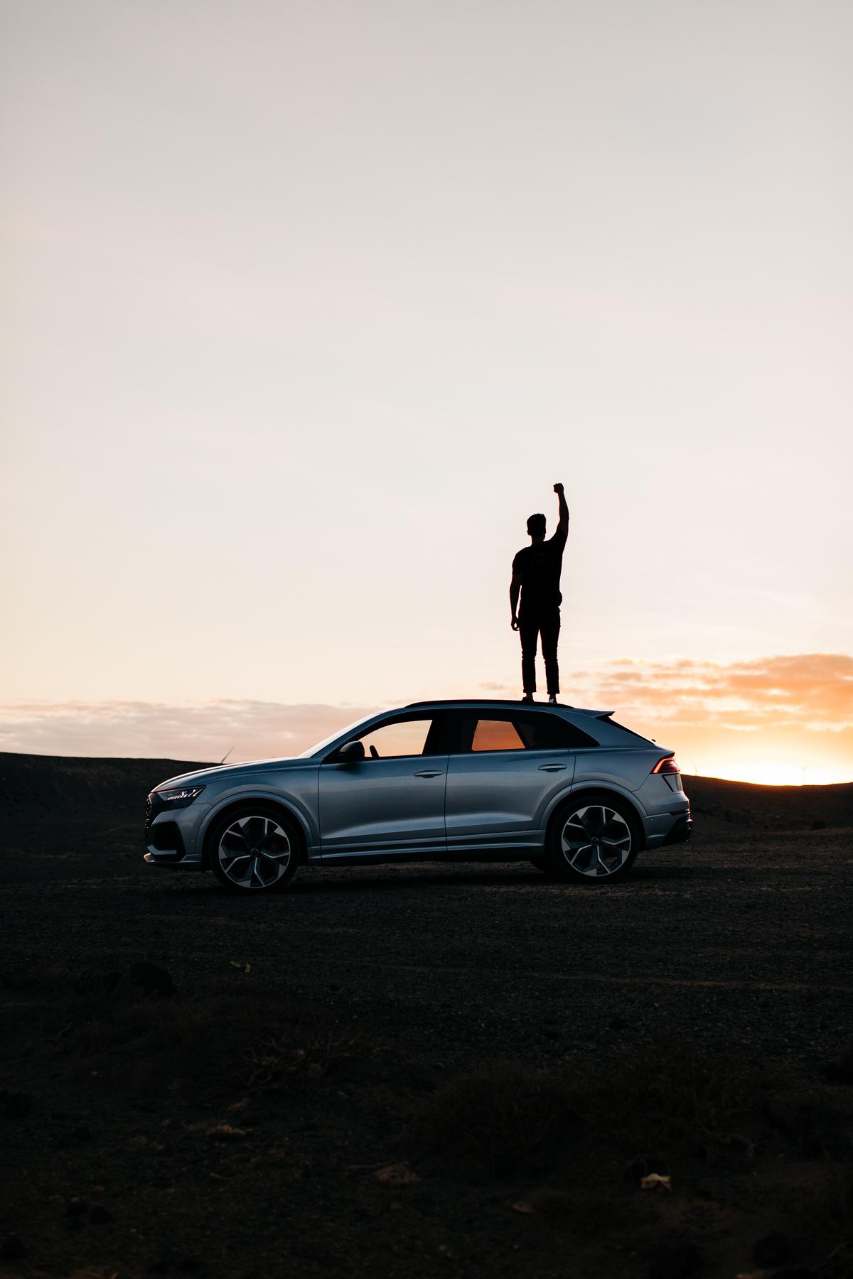 audi rsq8 sunset man power pose silhouette